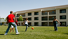students playing soccer on lawn