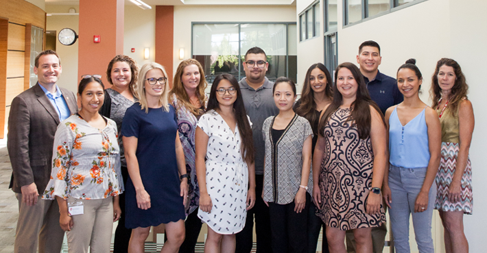 Stanislaus State faculty and staff are joined by Stanislaus Community Foundation representative, Martha Flores, to celebrate with the scholarship recipients.