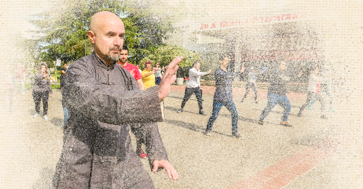 Instructor, Naser Ataee demonstrates T'ai Chi motions to students in the Fitzpatrick Arena courtyard.