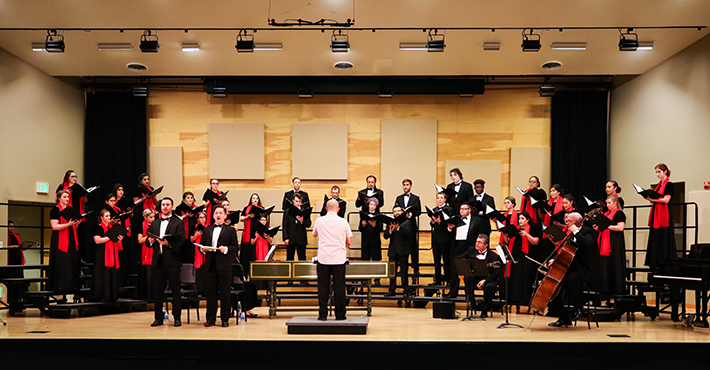 At far left, Guillermo Garcia Jr. ('14), baritone, and Owen McIntosh ('06), tenor, rehearse with the Stan State Concert Chorale under the direction of Dr. Daniel R. Afonso, Jr.