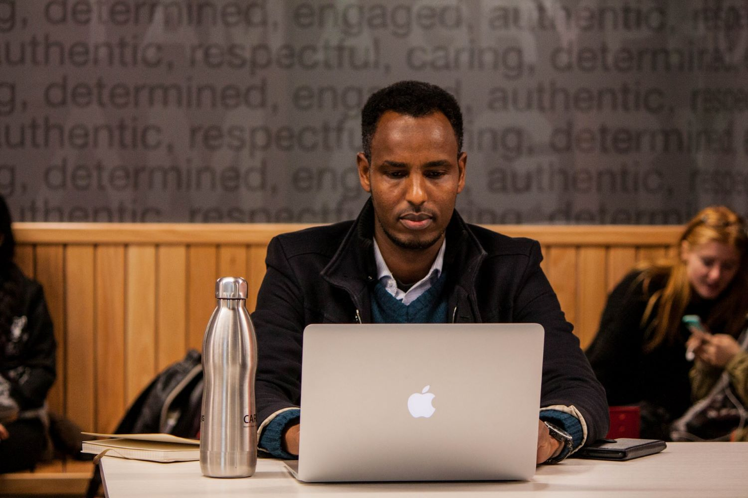 stock image of black student at a computer