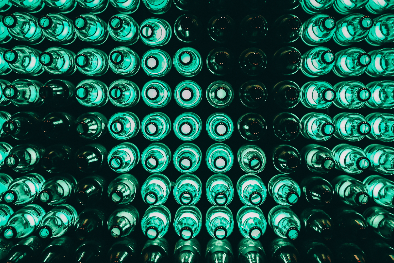 Green bottles lined up.