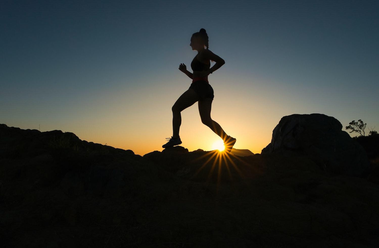Silhouette of female running.