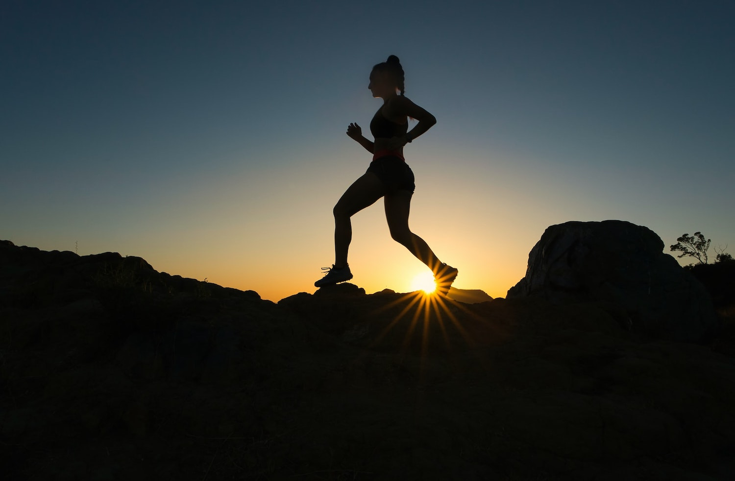 Silhouette of female running.