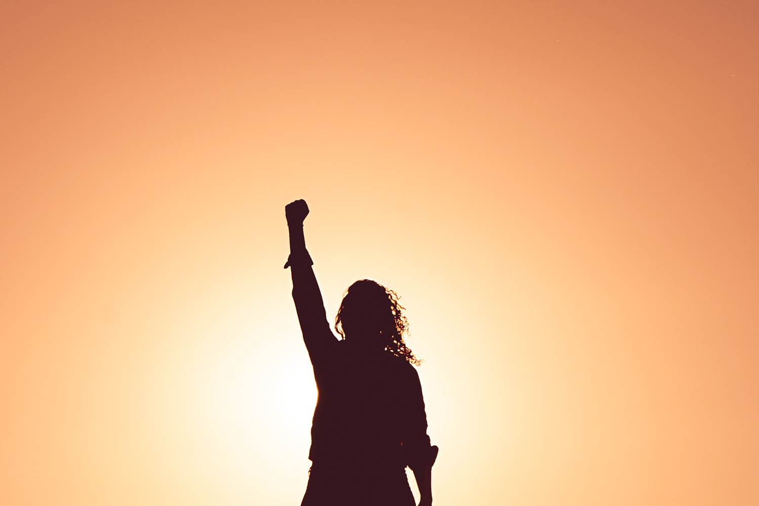 girl with her fist to the sky