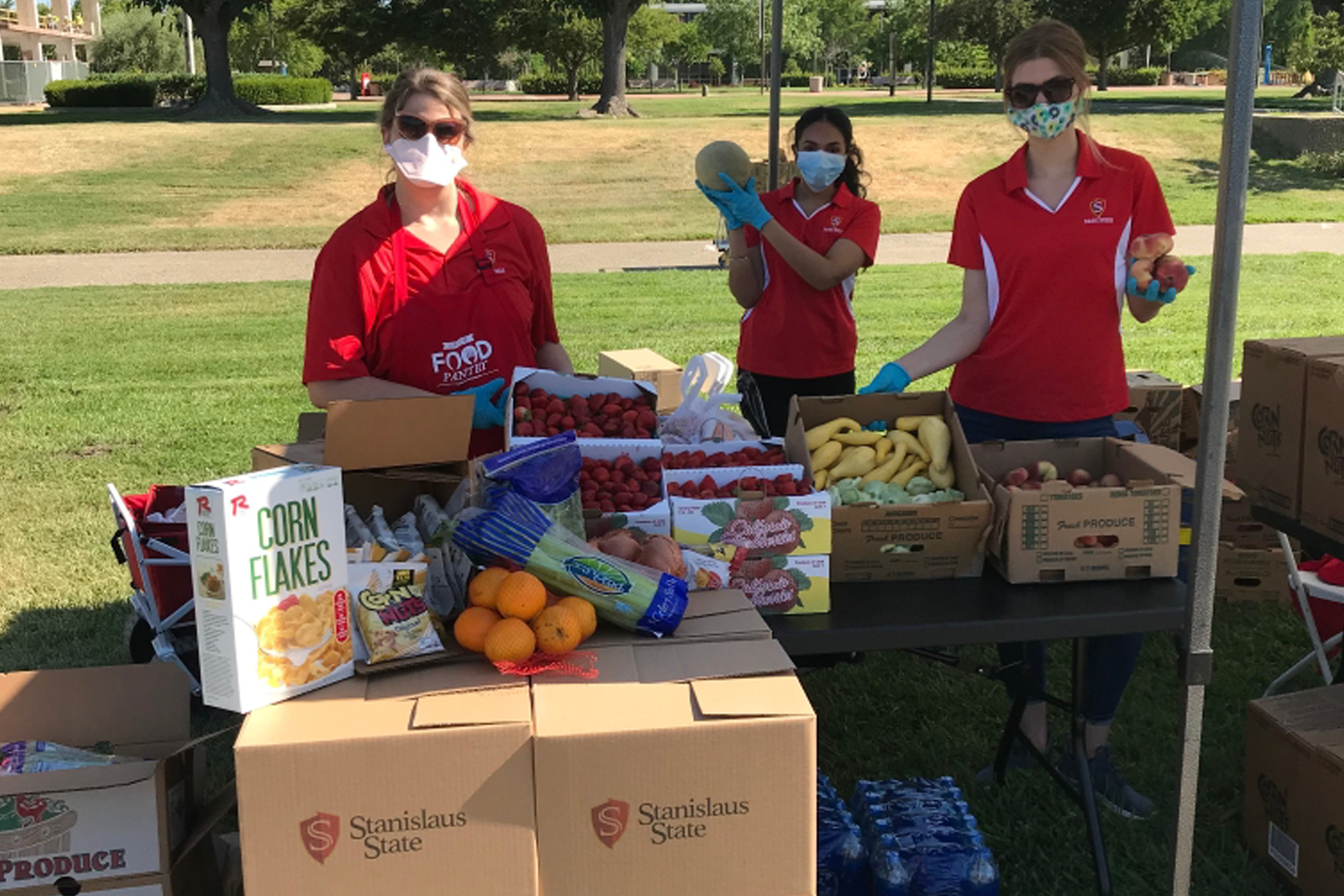 Stan State staff giving away fresh produce.