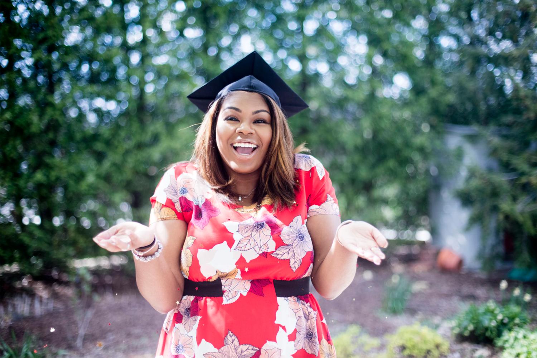 woman wearing graduation cap, shrugging shoulders