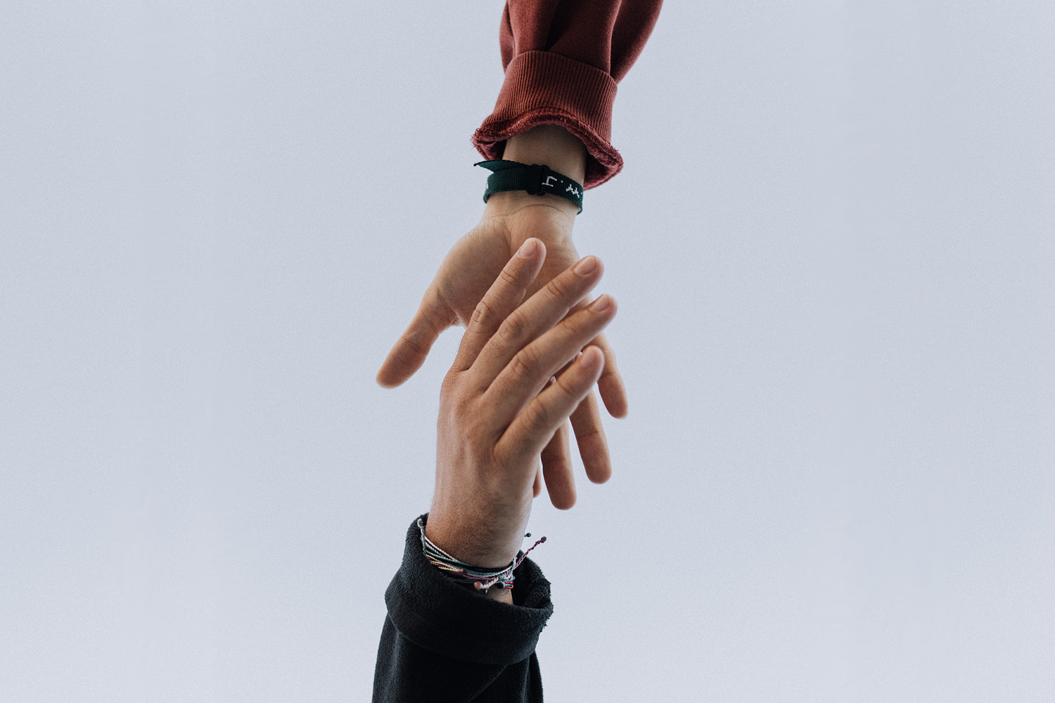 person reaching out to someone else