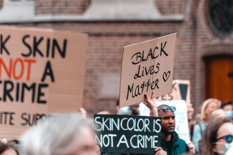 "protestor holding ""Black Lives Matter"" sign Joan Villalon unsplash.com"