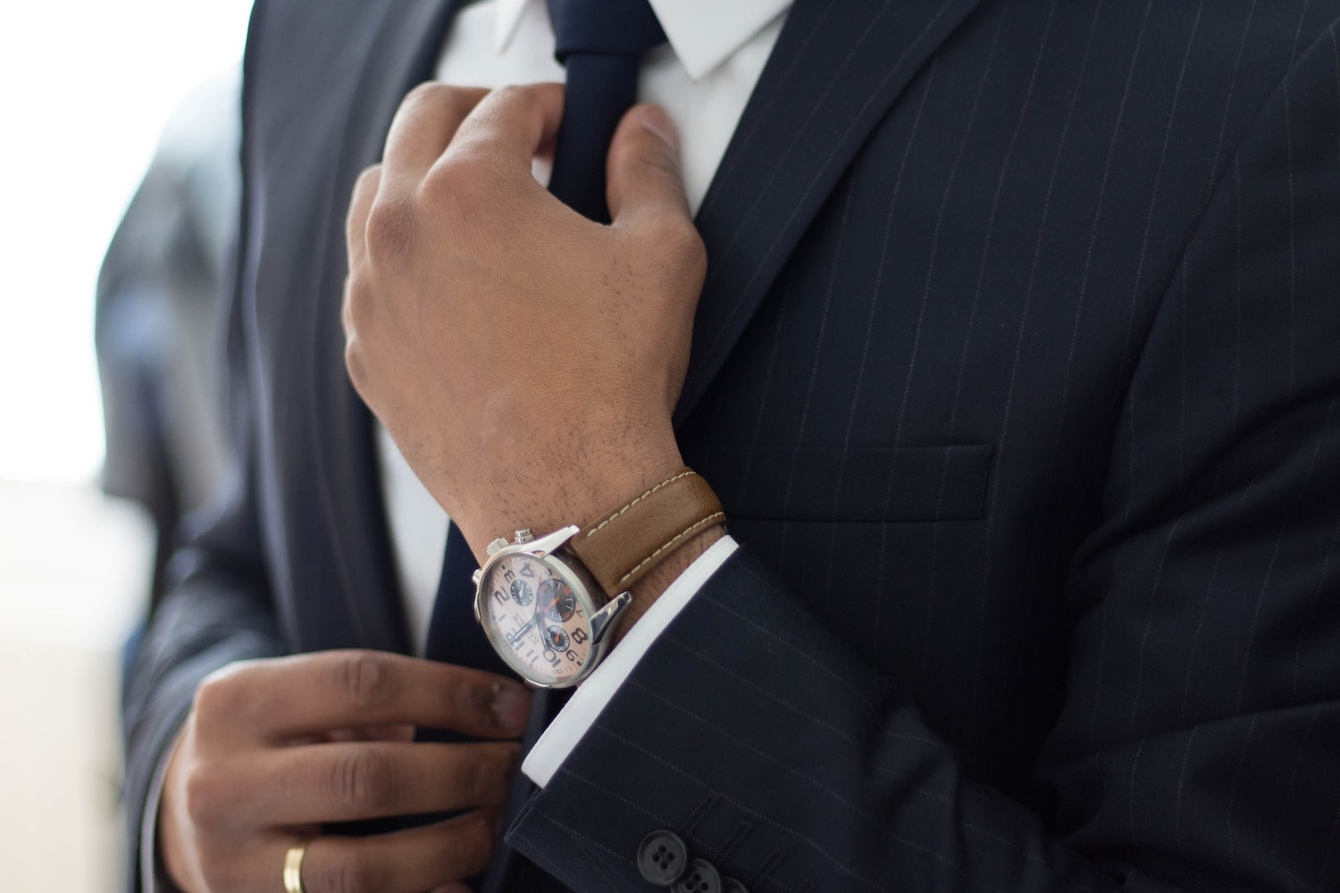 Close up image of man in suite and tie.