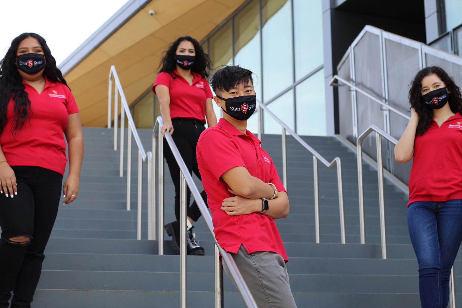 University students wearing face coverings.