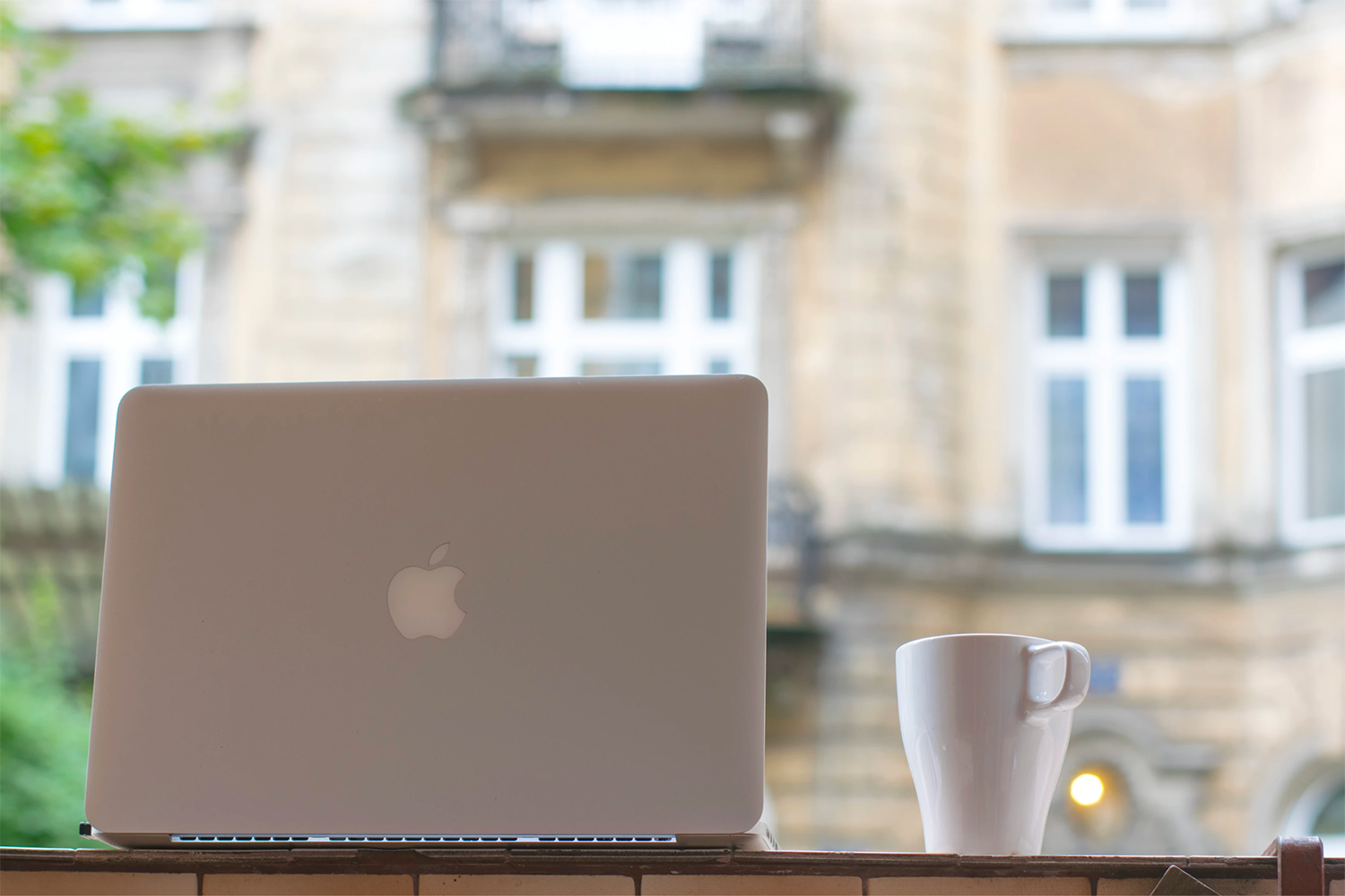 Laptop and a cup of coffee.