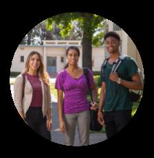 Three students smile.