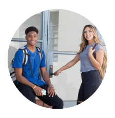 Two Students Smile.