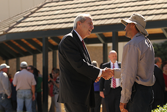 President Sheley greets faculty, staff, students and  guests before his 2015 annual address.