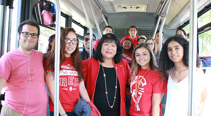 President Junn with students on public transportation