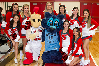 Stan State and Sonoma State mascots with Stan State cheer team