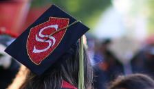 Grad with decorated grad cap.