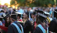 Graduates with regalia.