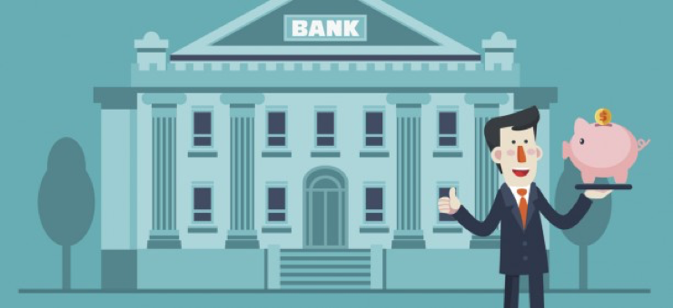 """A man is holding a piggy bank outside of a building labeled 'bank'"""""""