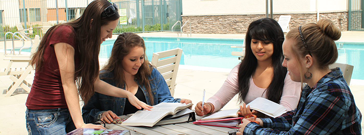 girls studying by pool