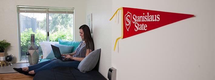 female student in dorm room