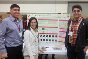 students presenting poster research