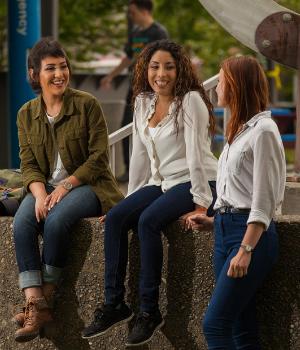 Group photo. Three students.