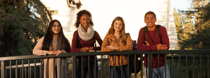 Four students smiling.
