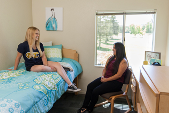 Female students hanging out in on-campus housing