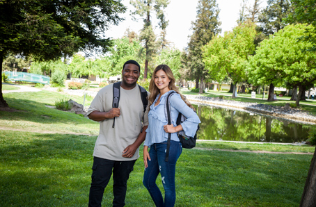 Tours (Two students posing in front of Warrior Lake)
