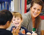 Student working with children in Child Development Center