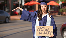 """college grad holding a sign stating """"now what"""""""