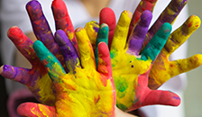 Children's hands with paint on them