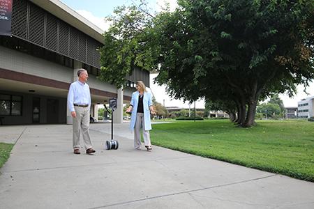 Matt Collin and Tawn Gillihan with telepresence robot