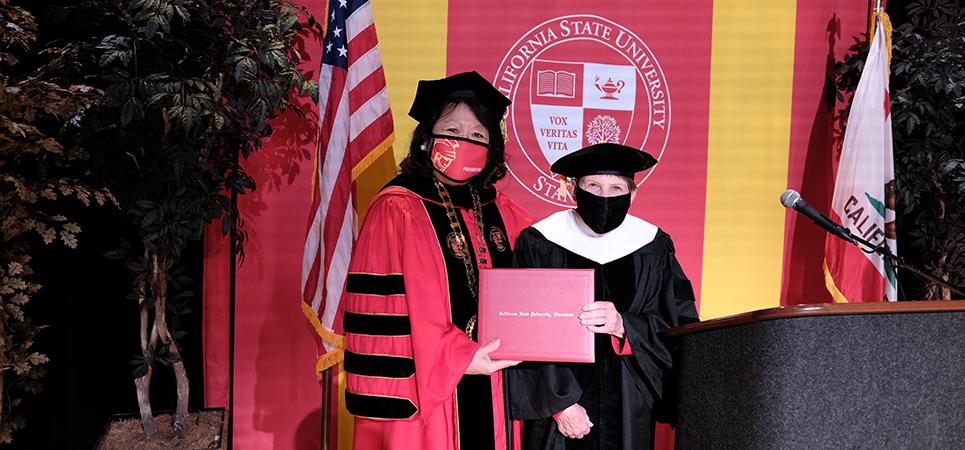 President Ellen Junn and Kenni Friedman