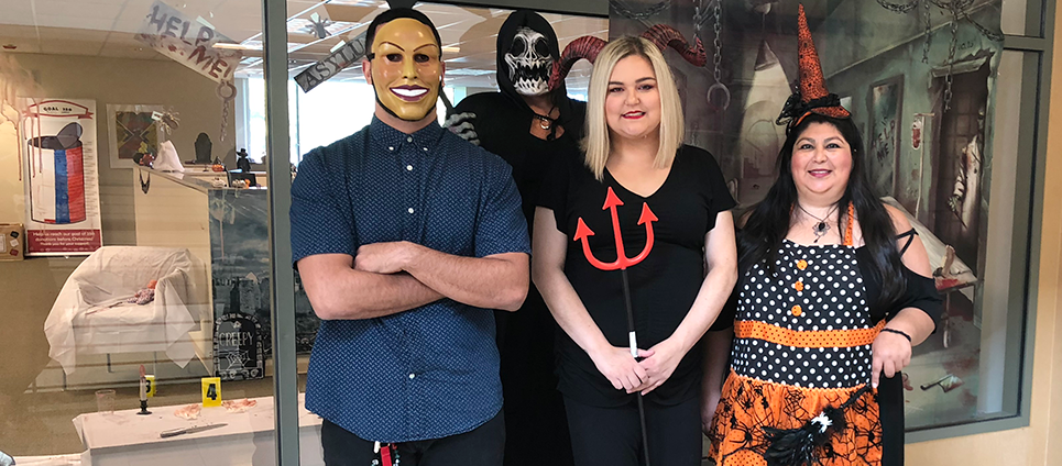 Laurie Marroquin (right) with Aimee Tatum and two masked employees