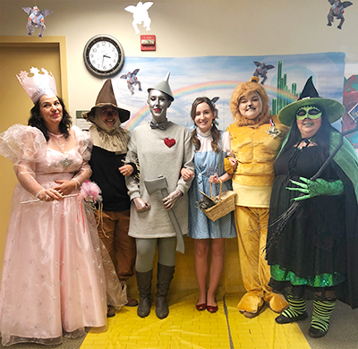 Laurie and coworkers dressed for halloween