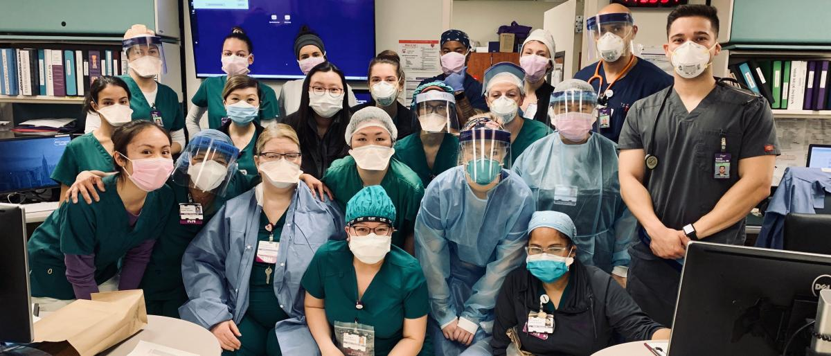 Alumnus Arnold Velasquez with nursing staff wearing PPE at NYU Langone