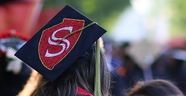 grads decorated cap from Commencement 2018