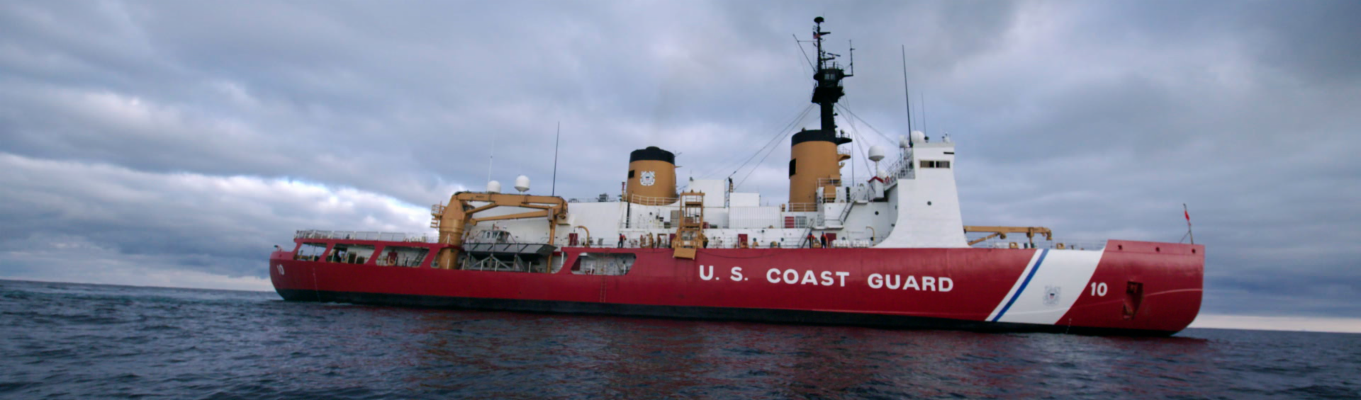 red and white US Coast Guard ship