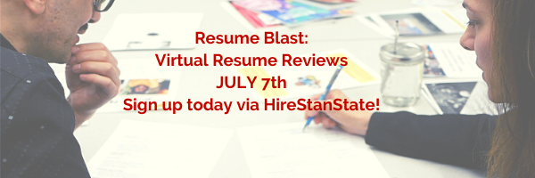 Two professionals reviewing a resume