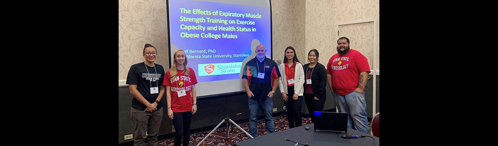 Exercise Science Students with Dr. Bernard presenting at a conference