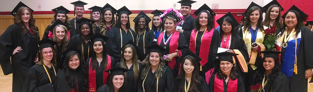 Group photo of graduates in cap and gowns