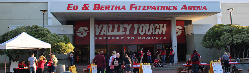 Front steps of Ed and Bertha Fitzpatrick Arena with booths set up in the foreground