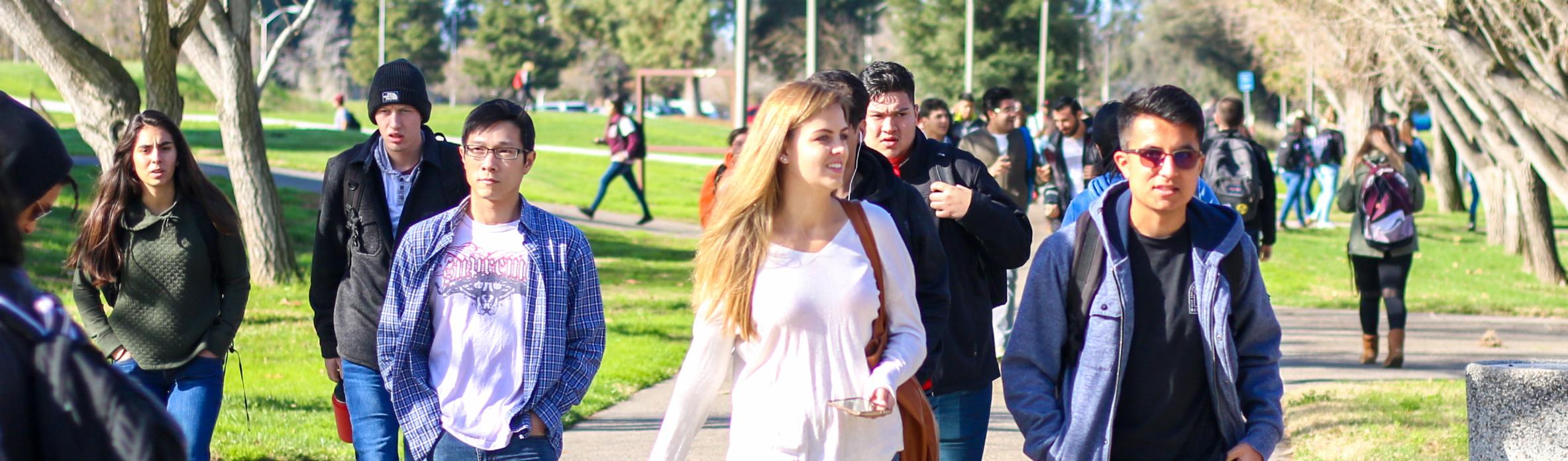 Students walking along pathway on campus