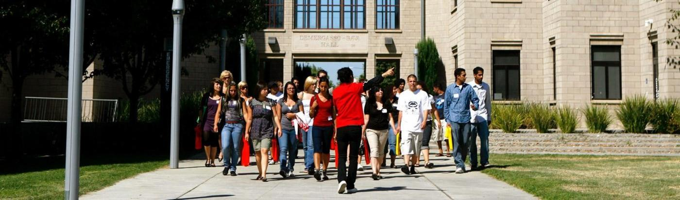 Picture of a group of people getting a tour around campus