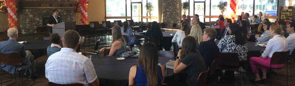 Group listening to speaker at welcome event in Main Dining