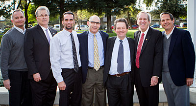 Economist Arthur Laffer (third from right), poses with Winton-Ireland, Strom & Green Chief Operating Officer Rick Adams (from left), CSU Stanislaus Provost James T. Strong, Winton-Ireland Chief Financial Officer Paul Porter, Winton-Ireland Chief Information Officer Michael Ireland, CSU Stanislaus President Joseph F. Sheley and Winton-Ireland Manager Jeff Quinn prior to Laffer's talk at CSU Stanislaus.