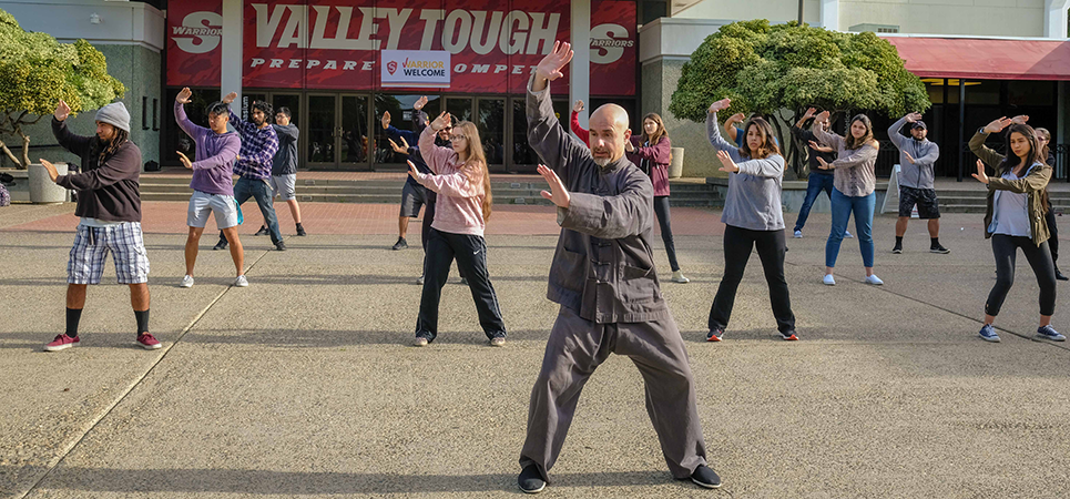Naser Ataee leads students in T'ai Chi on the Stan State campus.